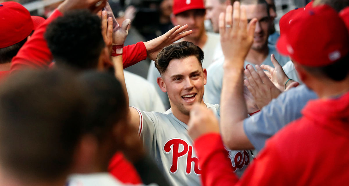 Phillies' Scott Kingery is greeted in the dugout after hitting a solo home run in the fourth inning June 14 (John Bazemore)
