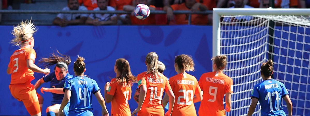 Stefanie Van Der Gragt (left) scores The Netherlands' second goal during the Women's World Cup quarterfinal against Italy on June 29 (Francisco Seco)