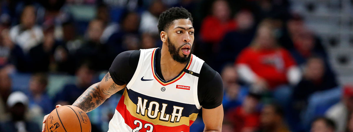 FILE - In this March 16, 2019, file photo, New Orleans Pelicans forward Anthony Davis brings the ball up during the first half of the team's NBA basketball game against the Phoenix Suns in New Orleans. (AP Photo/Tyler Kaufman, File)