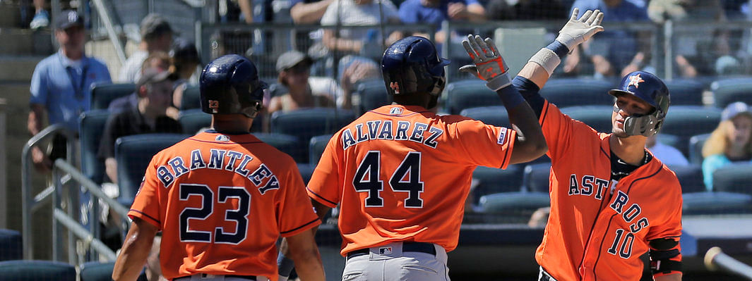 Astros' Yordan Alvarez (center) celebrates his two-run home run with Yuli Gurriel (right) and Michael Brantley (23) during the fifth inning on June 23 (Seth Wenig)