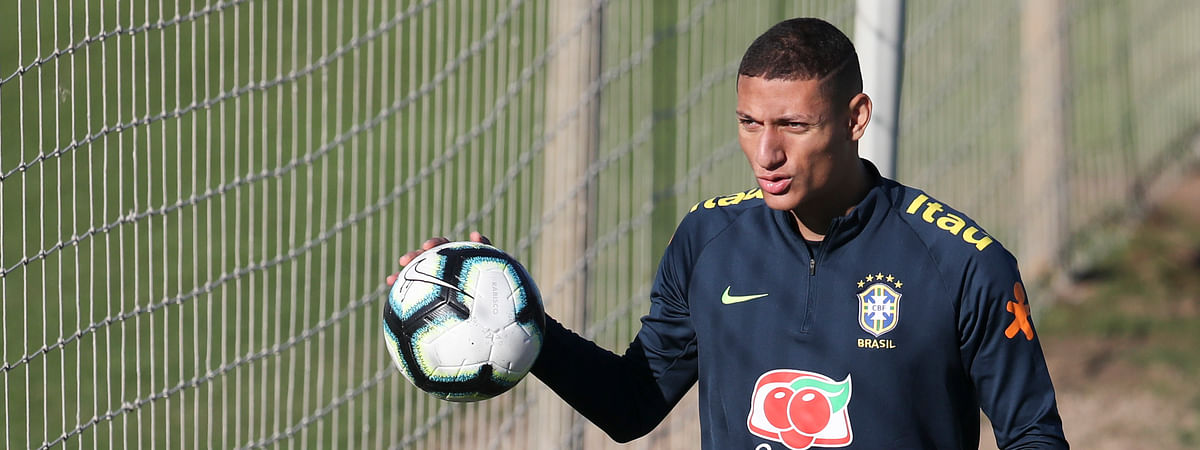 Richarlison holds a ball during a training session of Brazil national soccer team in Porto Alegre, Brazil, Wednesday, June 26, 2019. Brazil will play against Paraguay for a Copa America quarter-final match on June 27.(AP Photo/Natacha Pisarenko)