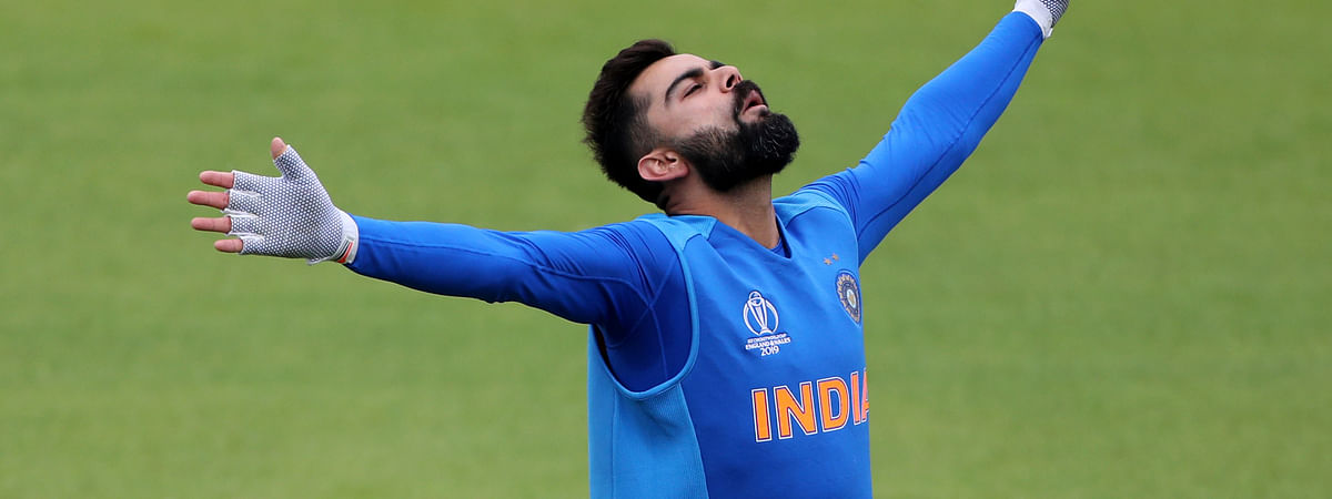 India's captain Virat Kohli gestures during a training session ahead of their Cricket World Cup match against Pakistan at Old Trafford in Manchester, England, Saturday, June 15, 2019. (AP Photo/Aijaz Rahi)