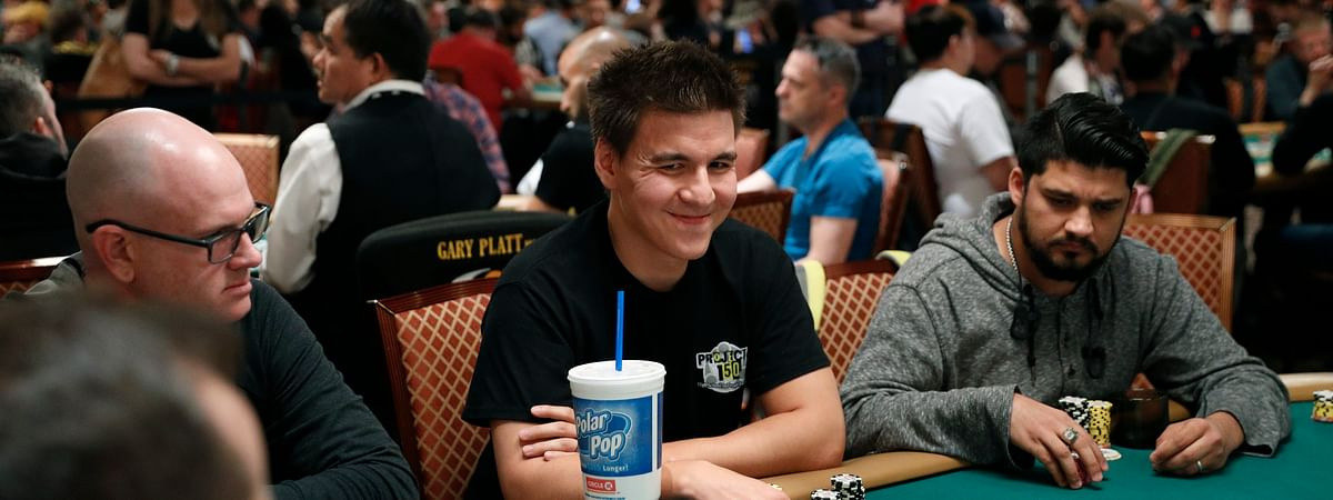 "In this June 24, 2019, file photo, ""Jeopardy!"" champion and professional sports gambler James Holzhauer, center, plays in a tournament at the World Series of Poker in Las Vegas."