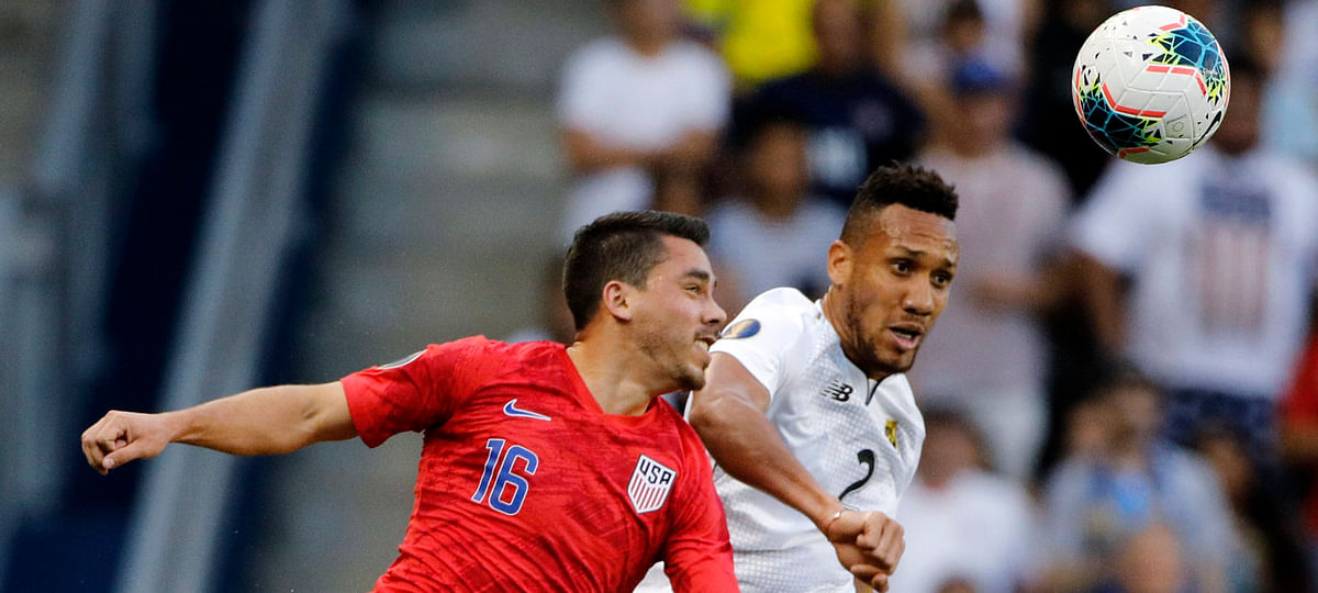 United States' Daniel Lovitz (16) and Panama' Francisco Palacios have their eyes on  the ball during the first half of a CONCACAF Gold Cup soccer match in Kansas City on  June 26 (Colin E. Braley)