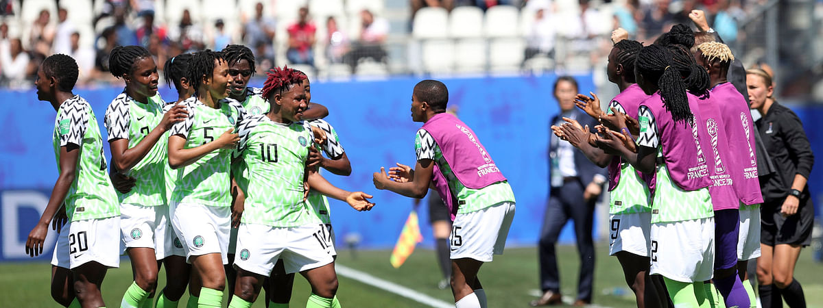 Nigeria players celebrate after taking the lead after South Korea scored an own goal on June 12 (Laurent Cipriani)