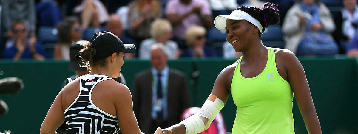 Ashleigh Barty (left) shakes hands with Venus Williams after winning their quarterfinal match of the Nature Valley Classic on June 21 (Nigel French/PA)
