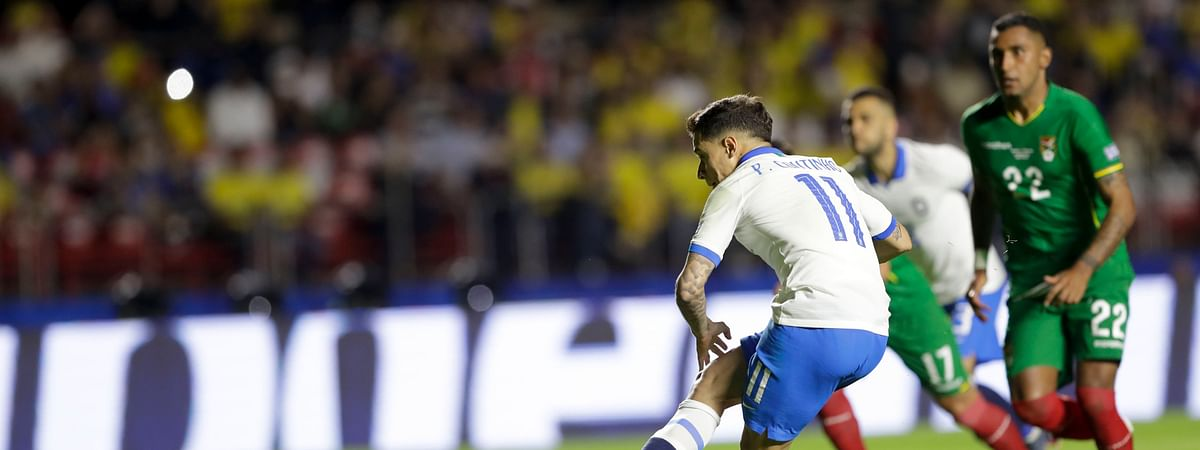 Brazil's Phlippe Coutinho scores from the penalty spot his side's opening goal  June 14  (Andre Penner)