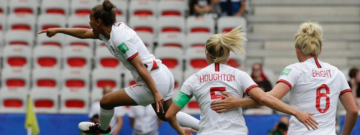 Nikita Parris (left) celebrates after scoring England's opening goal on a penalty kick on June 9 (Claude Paris)