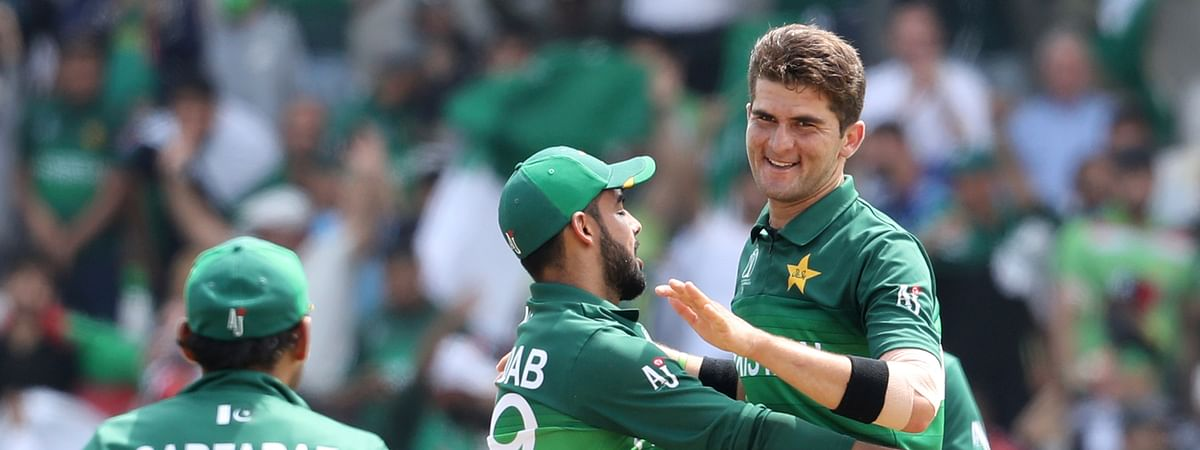 Pakistan's Shaheen Afridi, right, celebrates after the dismissal of Afghanistan's Najibullah Zadran during the Cricket World Cup match between Pakistan and Afghanistan at Headingley in Leeds, England, Saturday, June 29, 2019. (AP Photo/Rui Vieira)