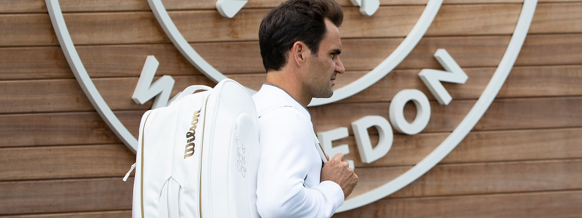 Roger Federer of Switzerland arrives for a training session at the All England Lawn Tennis Championships in Wimbledon, London, on Wednesday, June 26, 2019. The Wimbledon Tennis Championships 2019 will be held in London from July 1 to July 14. (Peter Klaunzer/Keystone via AP)