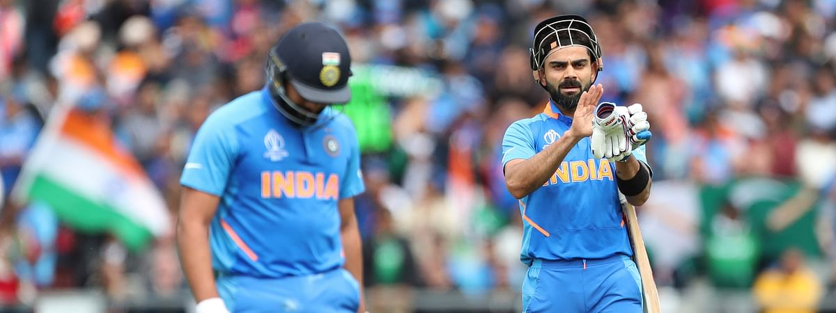 India's captain Virat Kohli, right, applauds teammate Rohit Sharma, left, as he leaves the field after losing his wicket during the Cricket World Cup match between India and Pakistan at Old Trafford in Manchester, England, Sunday, June 16, 2019. (AP Photo/Aijaz Rahi)