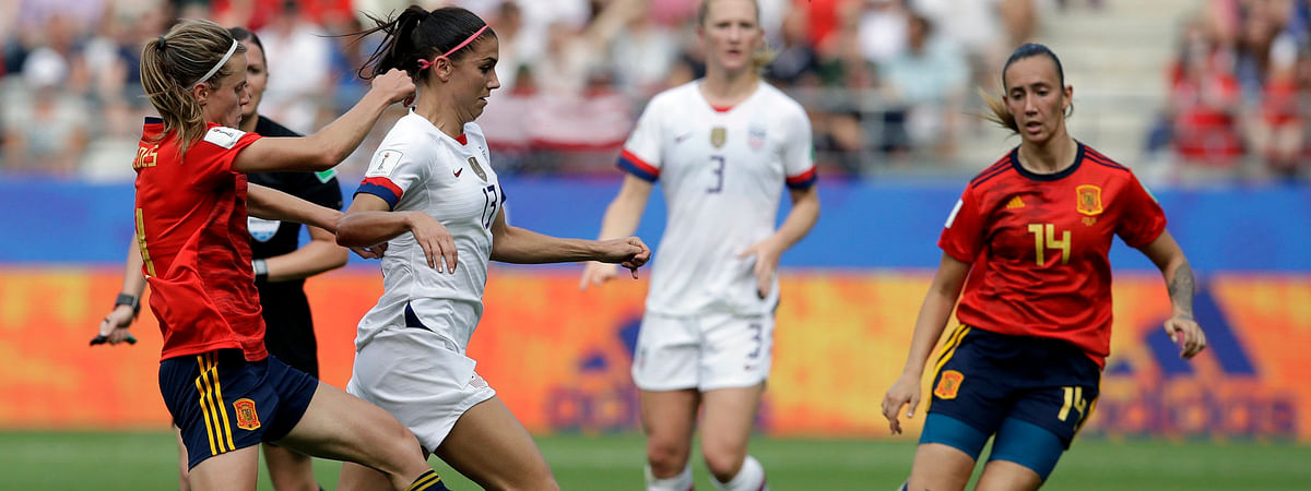 United States'Alex Morgan (13) is challenged by Spain's Irene Paredes (left) and Virginia Torrecilla on June 24 (Alessandra Tarantino)