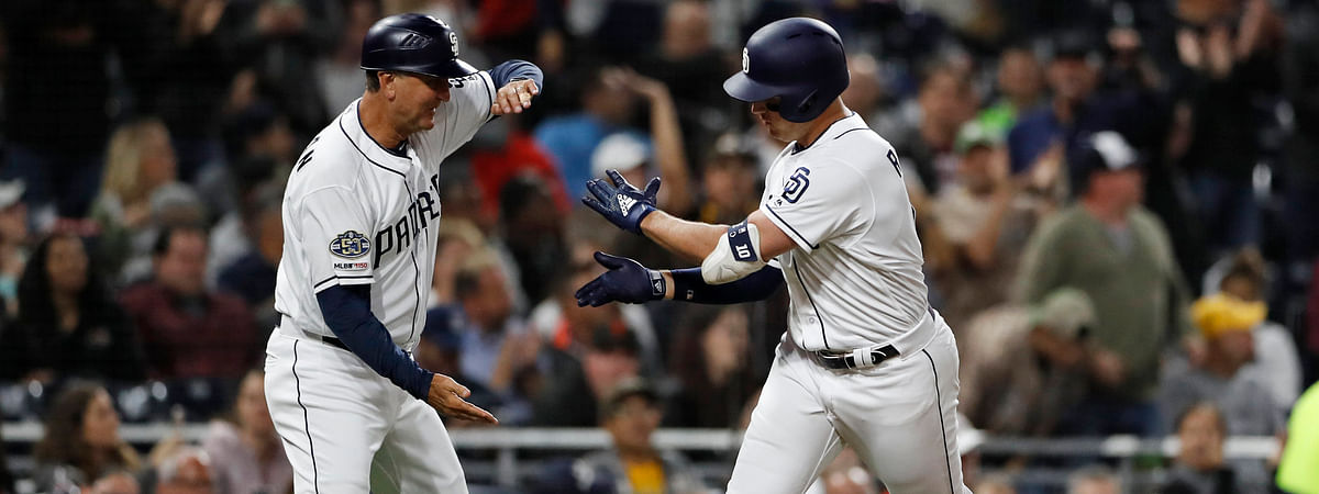 Padres' Hunter Renfroe (right) is greeted by third base coach Glenn Hoffman after hitting a two-run home run in the  second inning on June 6 (Gregory Bull)