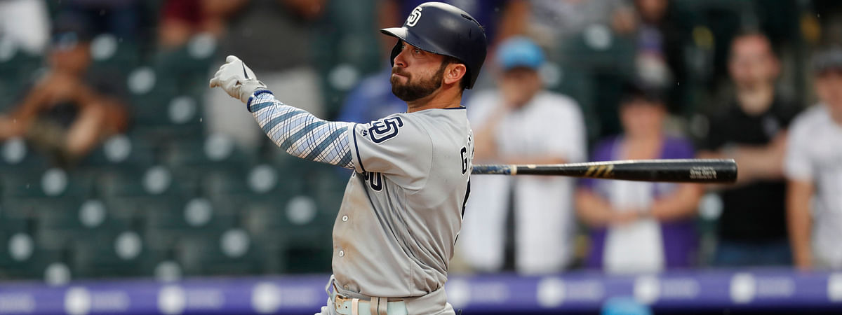 Padres' Greg Garcia triples in the 90th and 91st runs of the Padres-Rockies series on June 16 (David Zalubowski)