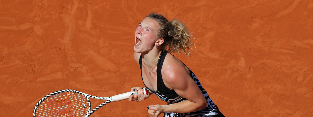 Katerina Siniakova of the Czech Republic celebrates winning her third round match of the French Open tennis tournament against Japan's Naomi Osaka in two sets, 6-4, 6-2, at the Roland Garros stadium in Paris, Saturday, June 1, 2019. (AP Photo/Michel Euler)