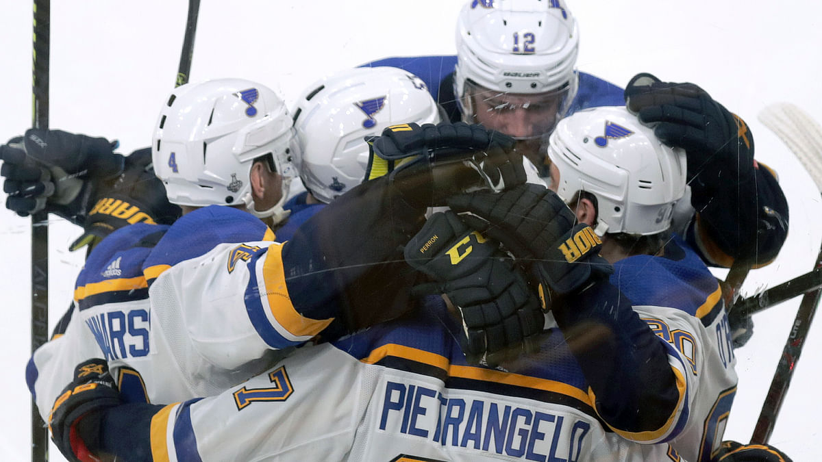 St. Louis Blues' Ryan O'Reilly, right, celebrates his goal against the Boston Bruins with teammates during the second period in Game 5 of the NHL hockey Stanley Cup Final, Thursday, June 6, 2019, in Boston. (AP Photo/Charles Krupa)