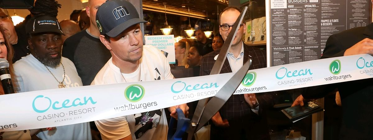 Movie star Mark Wahlberg cuts the ribbon to open the newest wahlburgers location, at Ocean Resort Casino.