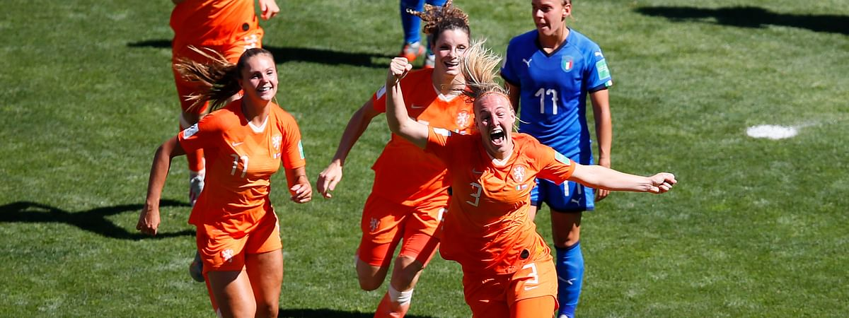 Netherlands' Stefanie Van Der Gragt, front, celebrates after scoring her side's second goal during the Women's World Cup quarterfinal soccer match between Italy and the Netherlands, in Valenciennes, France, Saturday, June 29, 2019. (AP Photo/Francois Mori)