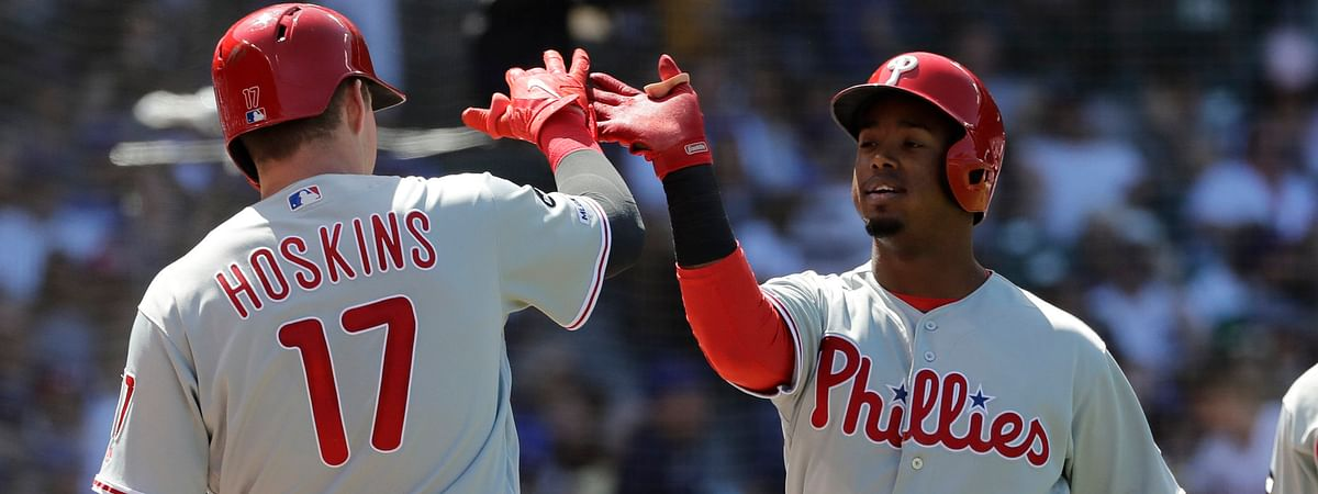 Phillies' Jean Segura is met by Rhys Hoskins after hitting a  two-run home run in the fourth inning to give the Phillies a 7-0 lead over the Cubs on May 23.