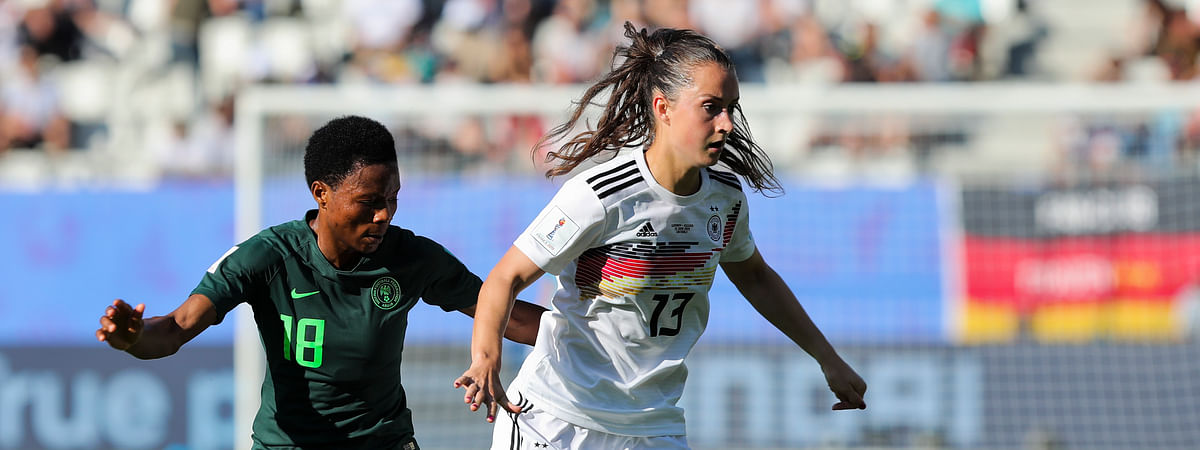 Germany's Sara Daebritz, right, vies for the ball with Nigeria's Halimatu Ayinde during the Women's World Cup round of 16 soccer match between Germany and Nigeria at Stade del Alpes in Grenoble, France, Saturday, June 22, 2019. (AP Photo/Laurent Cipriani)