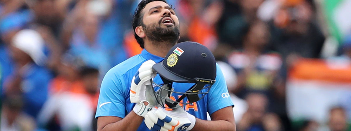 India's Rohit Sharma looks skywards to celebrate scoring a century during the Cricket World Cup match between India and Pakistan at Old Trafford in Manchester, England, Sunday, June 16, 2019. (AP Photo/Aijaz Rahi)