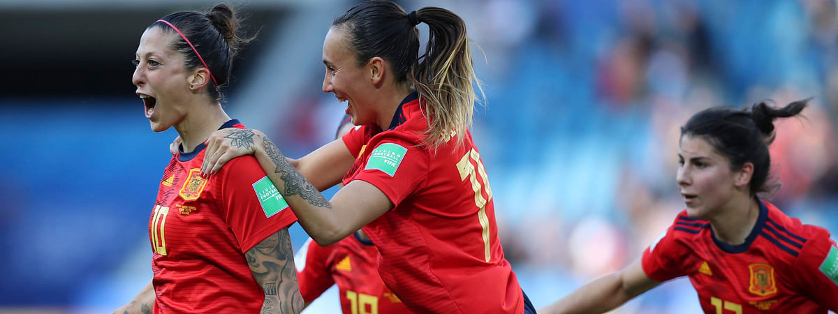 Spain's Jennifer Hermoso (left) celebrates with teammates after scoring on a penalty shot June 8 (Francisco Seco)