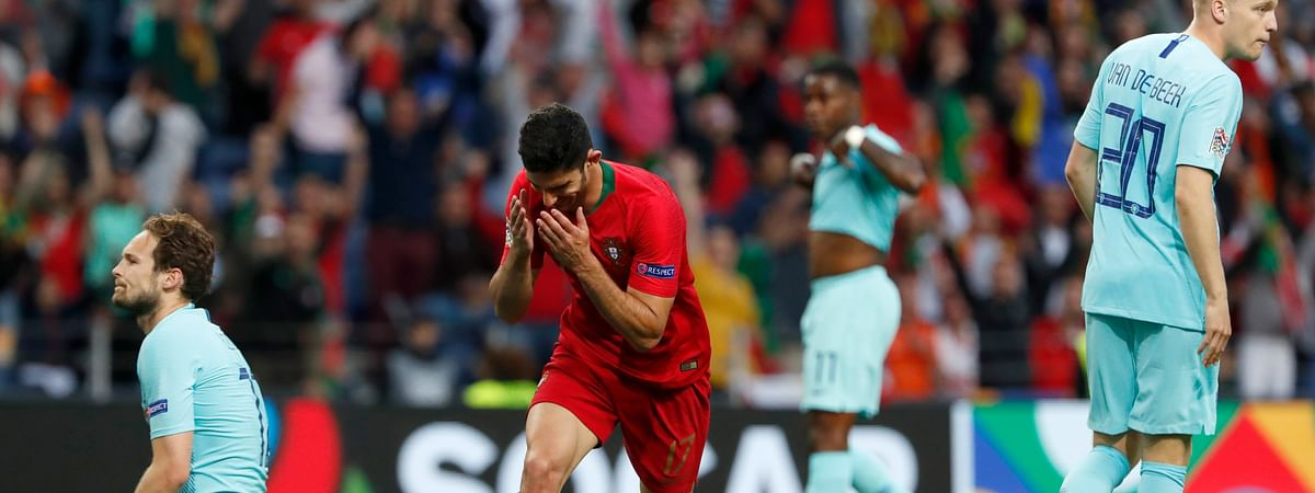 Portugal's Goncalo Guedes, centre, reacts after scoring his team's first goal during the UEFA Nations League final soccer match between Portugal and Netherlands at the Dragao stadium in Porto, Portugal, Sunday, June 9, 2019. (AP Photo/Armando Franca)