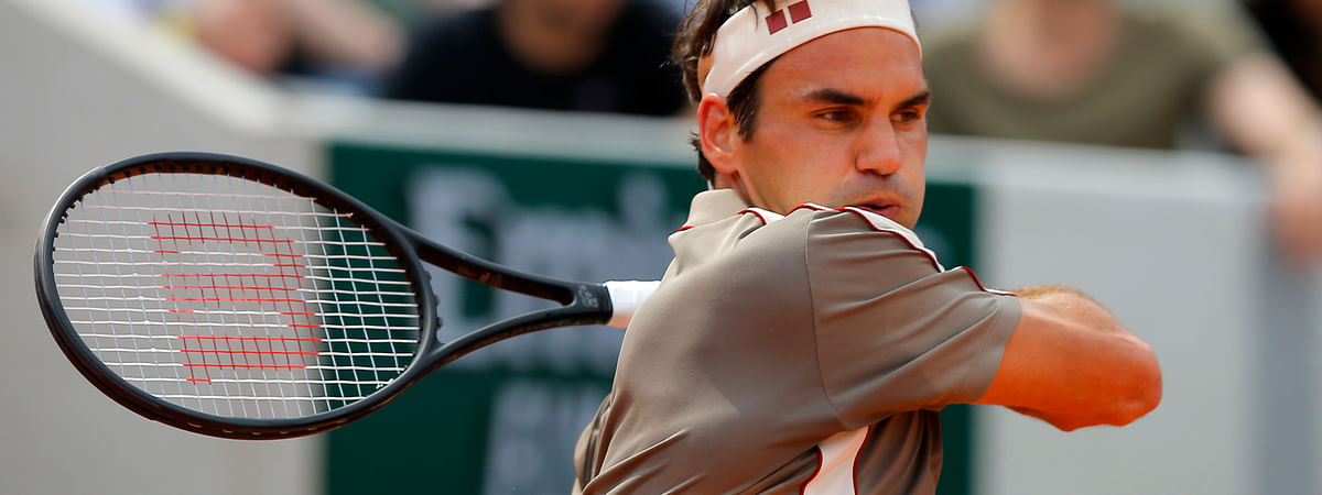 This Swiss don't miss: Switzerland's Roger Federer plays a shot against Switzerland's Stan Wawrinka during their quarterfinal match of the French Open tennis tournament at the Roland Garros stadium in Paris, Tuesday, June 4, 2019. (AP Photo/Michel Euler)