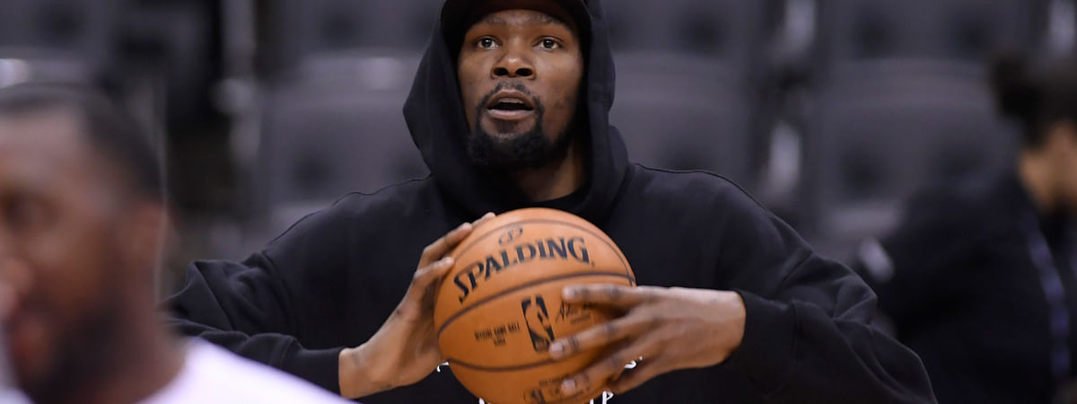 Golden State Warriors Kevin Durant watches during basketball practice at the NBA Finals in Toronto, Saturday, June 1, 2019. (Nathan Denette/The Canadian Press via AP)