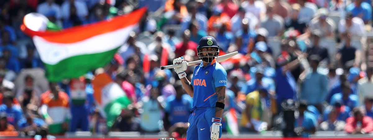 India's captain Virat Kohli follows the ball after playing a shot during the Cricket World Cup match between India and West Indies at Old Trafford in Manchester, England, Thursday, June 27, 2019. (AP Photo/Jon Super)
