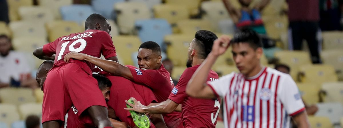 Qatar players celebrate their side's second goal against Paraguay, scored by Boualem Khoukhi, during a Copa America Group B soccer match at the Maracana stadium in Rio de Janeiro, Brazil, Sunday, June 16, 2019. (AP Photo/Silvia Izquierdo)