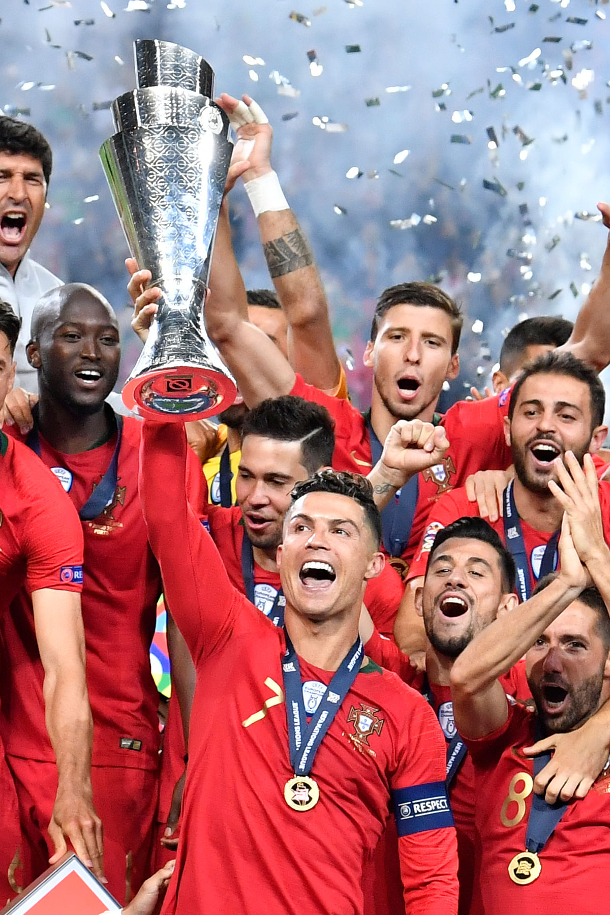 Portugal's Cristiano Ronaldo lifts up the trophy as he celebrates with players after winning the UEFA Nations League final soccer match between Portugal and Netherlands at the Dragao stadium in Porto, Portugal, Sunday, June 9, 2019. Portugal won 1-0. (AP Photo/Martin Meissner)