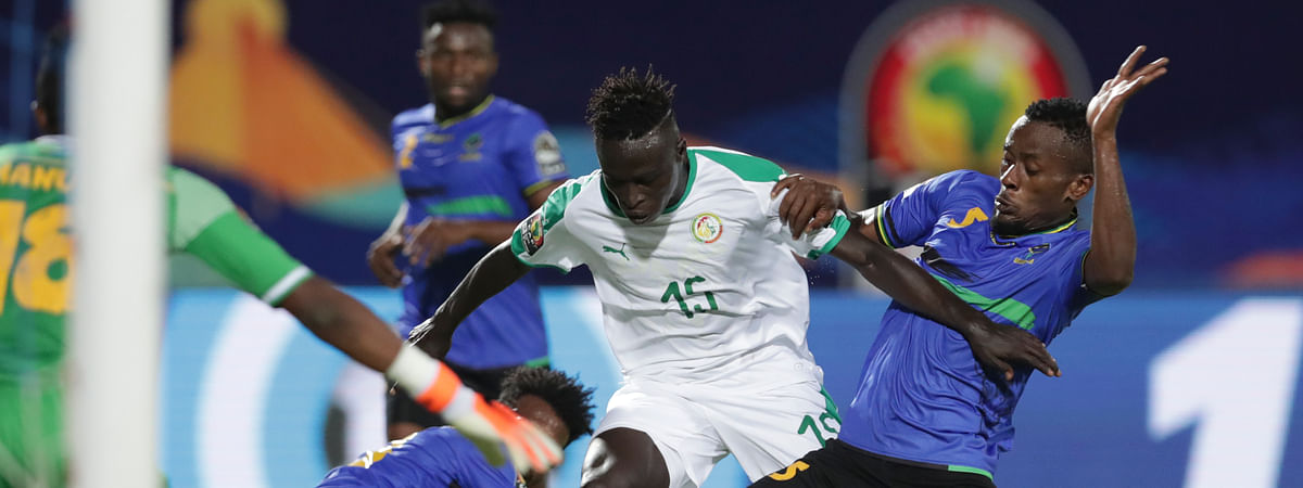 Senegal's Krepin Diatta, left, and Senegal's Idrissa Gana Gueye fight for the ball during the African Cup of Nations group C soccer match between Senegal and Tanzania at 30 June Stadium in Cairo, Egypt, Sunday, June 23, 2019. (AP Photo/Hassan Ammar)