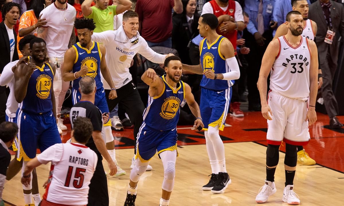Stayin' Alive: Warriors rally late to beat Raptors 106-105, to force Game 6; Curry, Thompson combine for 57