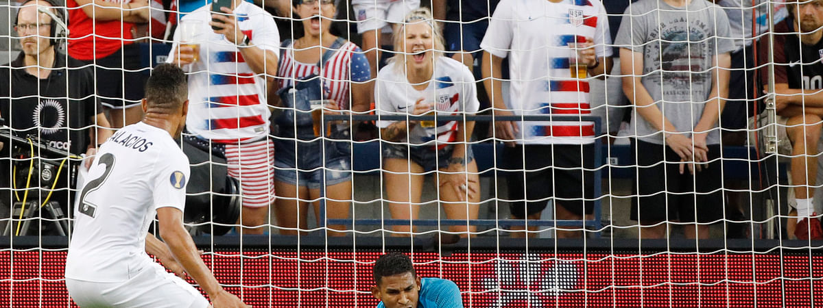 Panama goalkeeper Jose Calderon (12) blocks a shot against the United States as defender Francisco Palacios (2) watches during the first half of a CONCACAF Gold Cup soccer match in Kansas City, Kan., Wednesday, June 26, 2019. (AP Photo/Colin E. Braley)