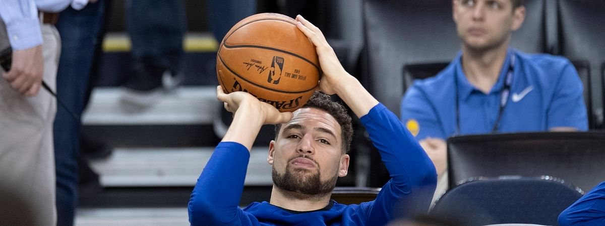 Warriors' Klay Thompson practices his shot motion from the bench during practice on June 4 (Frank Gunn/The Canadian Press)