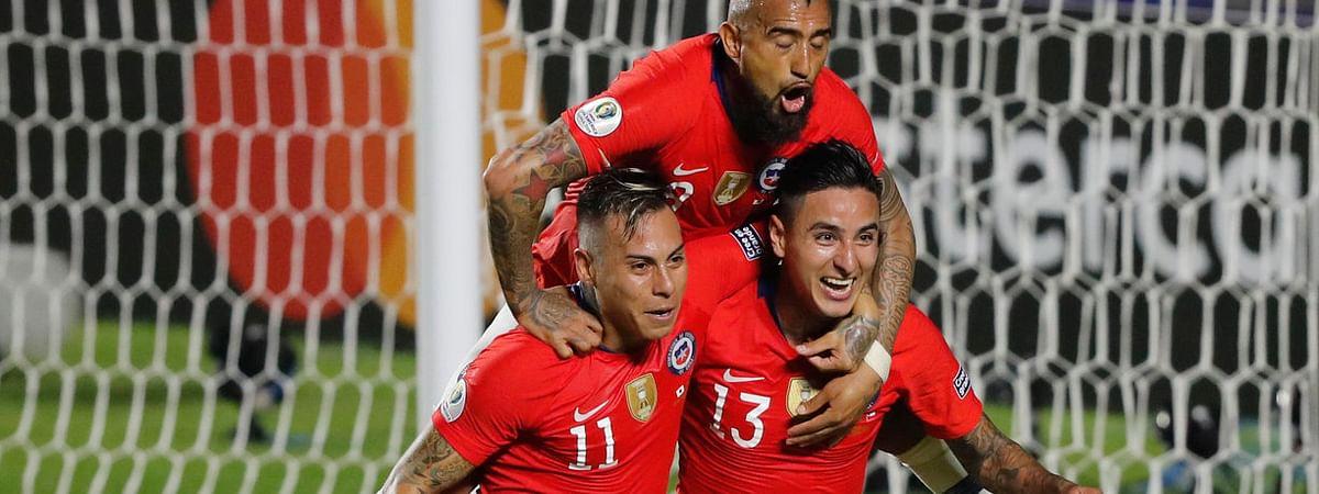 Chile's Erick Pulgar (bottom right) celebrates scoring a goal  goal with teammates Eduardo Vargas (left) and Arturo Vidal during a Copa America Group C  match on June 17 (Nelson Antoine)