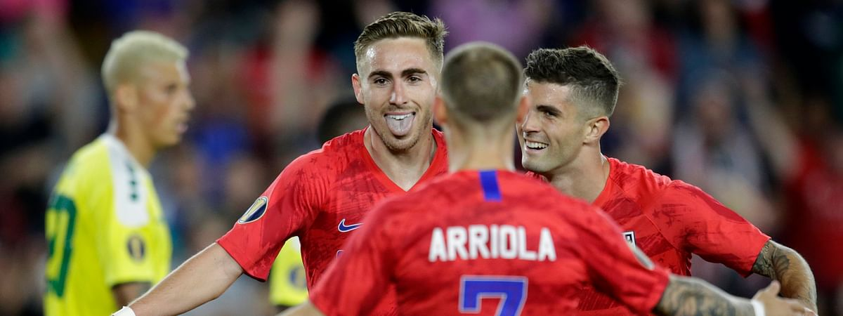 United States' Tyler Boyd (facing camera) celebrates with teammates Paul Arriola (7) and Christian Pulisic  as Guyana's Matthew Briggs walks away during the second half on  June 18  (Andy Clayton-King)