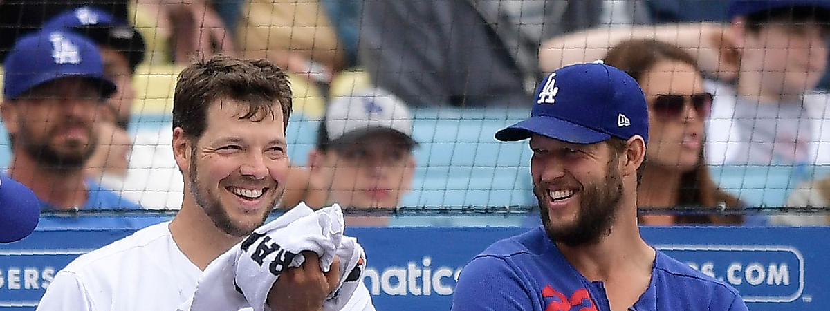 Dodgers starting pitcher Rich Hill (left) and Clayton Kershaw talk in the dugout during the seventh inning against the Phillies on June 2 (Mark J. Terrill)