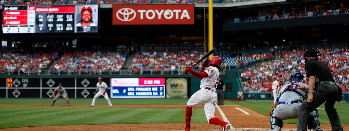 Phillies' Roman Quinn hits a run-scoring single against the Mets on June 24 (Matt Slocum)