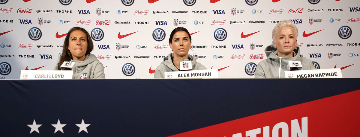 United States women's national soccer team members (from left): Carli Lloyd, Alex Morgan and Megan Rapinoe speak to reporters during a news conference in New York on  May 24 (Seth Wenig)
