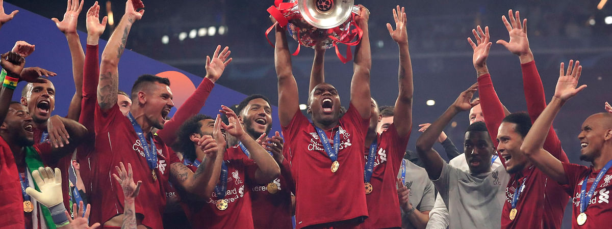 Liverpool's Daniel Sturridge, center, with trophy, received a two-week ban for betting violations. (AP File Photo)