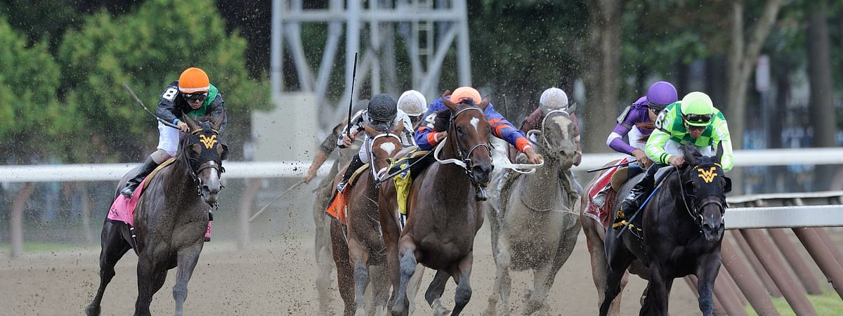 Horses head down the stretch at Saratoga
