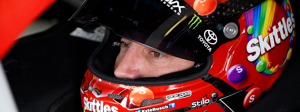 Kyle Busch sits in his car before a practice session for Sunday's NASCAR Cup Series auto race, Saturday, July 27, 2019, in Long Pond, Pa. (AP Photo/Derik Hamilton)