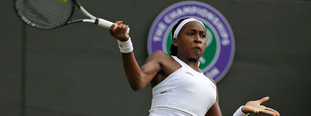 """United States' Cori """"Coco"""" Gauff returns to United States's Venus Williams in a Women's singles match during day one of the Wimbledon Tennis Championships in London, Monday, July 1, 2019. (AP Photo/Tim Ireland)"""