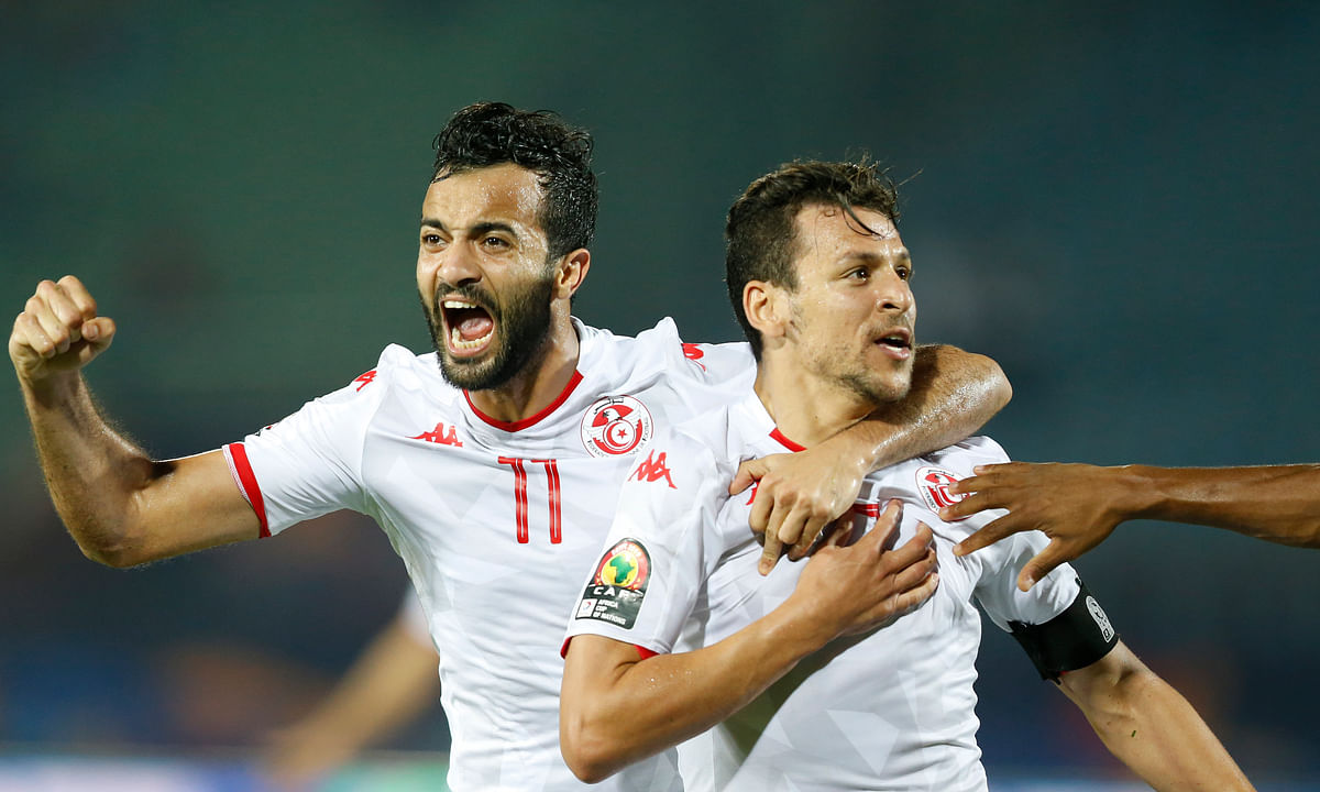 Tunisia tops Cinderella Madagascar 3-0 at African Cup, Algeria beats Ivory Coast in a shootout – both winners advance to semifinals