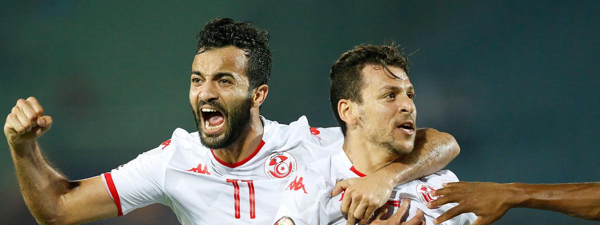 Tunisia's Youssef Msakni, right and Tunisia's Taha Khenissi celebrate after scoring during the African Cup of Nations quarterfinal soccer match between Madagascar and Tunisia in Al Salam stadium in Cairo, Egypt, Thursday, July 11, 2019. (AP Photo/Ariel Schalit)