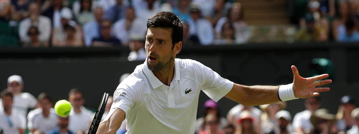 Serbia's Novak Djokovic returns to Germany's Philip Kohlschreiber in a Men's singles match during day one of the Wimbledon Tennis Championships in London, Monday, July 1, 2019.