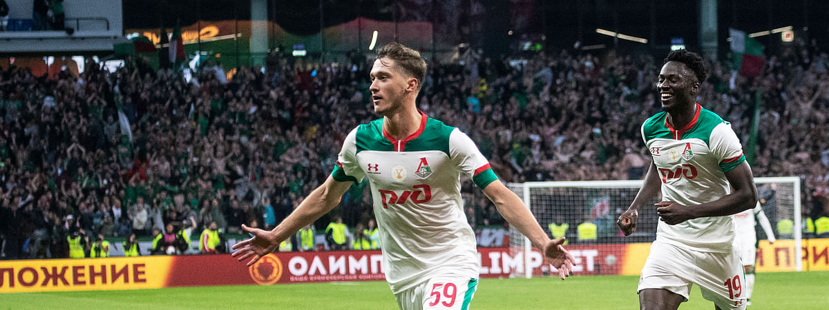 Lokomotiv Moscow's Aleksei Miranchuk, center, celebrates after scoring his team's third goal against Zenit St. Petersburg during the Russian Super Cup soccer match in Moscow, Russia, Saturday, July 6, 2019. Lokomotiv won 3-2.