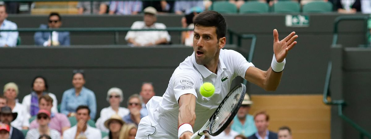 Serbia's Novak Djokovic returns the ball to Ugo Humbert of France in a men's singles match during day seven of the Wimbledon Tennis Championships in London, Monday, July 8, 2019. (AP Photo/Kirsty Wigglesworth)